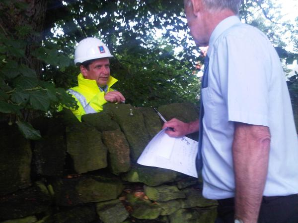 Ecology Building Society chief operating officer George Haslem talks with contractors in a bid to save the tree