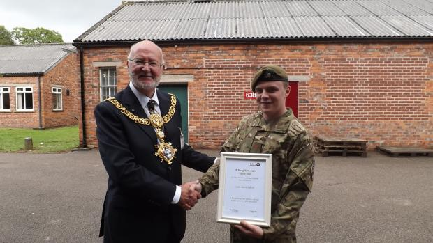 Keighley town mayor Coun Graham Mitchell congratulates Cadet Sgt Aaron Jefford on his award