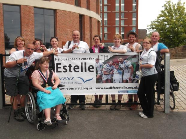 The Team Estelle walkers at the end of their demanding trek, all with finishing medals. At the front are, from left,  Alistair Dickinson, his daughter Estelle, and Estelle's older sister Chantelle