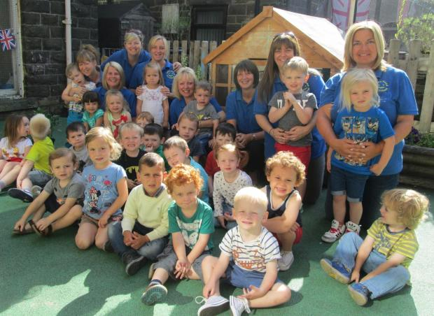 "Staff and children at Exley Head Pre-school, which has been rated ""Good"" by Ofsted"