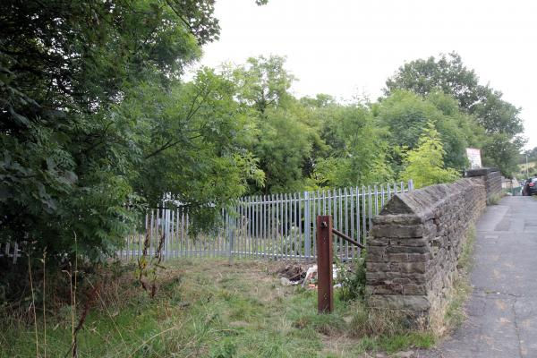 The new fence at the entrance to the land