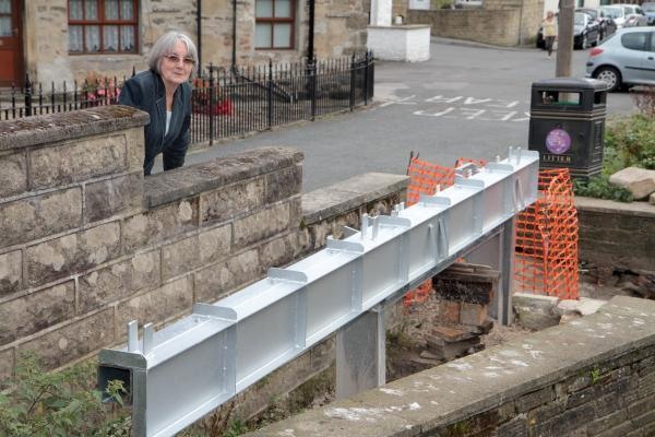 Val Carroll next to the girders at Silsden Beck