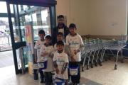 The young charity cash collectors and supervisor Faheem Rahman at Keighley's Morrisons