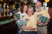 Colleen Holiday, centre, Denny Cornell and Fred Baker, of CAMRA, with the Ale Trail guide