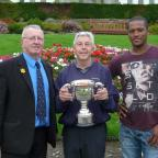 Keighley News: David Scott shows off the Skipton Merit trophy alongside runner-up Ian Bernard, right, and Skipton League president Warren Burnett. It is the second time Scott has won the title – 45 years after his first success in the competition