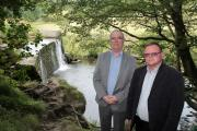 Councillor Brian Morris, left, and town councillor John Kirkby stand near the weir that was the scene of a rescue when a boy fell into the North Beck, downstream of Tinker Bridge, between Fell Lane and North Dean Road