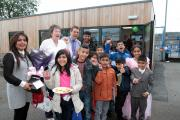 Holycroft Primary School governors Councillor Kaneez Akthar, left, and former deputy head Liz Docwra, second from left, join pupils, parents and staff at the opening of the community learning hub