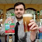 Keighley News: Scott Wilkins of G Moore and Company with the special Cougars ale