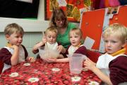 Foundation stage teacher Cath Bellwood joins Stanbury Primary School pupils in a baking session: from left, Joe Whittaker, four, Sonny Roche, four, Neve Garbutt, five, and Henry Atkins, four (11582343)