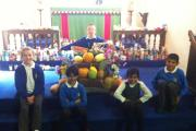 Riddlesden St Mary's Rowan class pupils with some of their donated food. At the back is Kaeden Young. Front row, from left, Jessica Bennison, Thayba Ali, Sahar Tariq and Danny Ilyas.