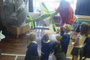 Reception pupils at Long Lee Primary receive a flight demonstration delivered by a team from Keighley and District Model Aircraft Club