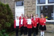 Hothfield Junior School pupils with one of the First World War posters