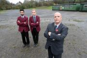 Holy Family School assistant headteacher David Metcalfe is joined by students Zain Hussain and Annabelle Ferrarra at the site of a proposed sports area (12489634)
