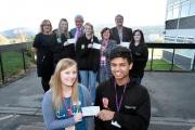 Hayley Ibbotson of Manorlands, front, receives a cheque from Oakbank School student Kashim Ali with, from left, Cherry Bugler of the Principle Trust, student Katie Pickles, Mike Davies of the Principle Trust, student Sarah Waller, Helen Verity of NSPCC, D