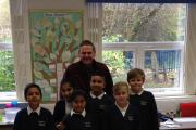 Mike Armstrong, pictured with some of the Parkwood Primary School students that he has been helping