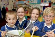 Sutton C of E Primary School Pupils Nathan Knight, Lily Darroch, Evie Holmes and Harry Hutchinson make soup with veg grown in the School garden. (12735647)