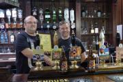 Lee Barras, left, of Doncaster CAMRA, presents the certificate to Bridgehouse Brewery head brewer Ian Cowling