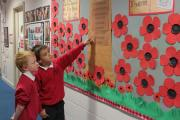 Year four pupils Samuel Spencer and Daniel Turner look at the exhibition at Cullingworth Primary School