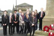 Parkside School students at the Cullingworth war memorial with, from left, school head Andrew Taylor and deputy head Bernard Tague.