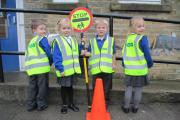 Oakworth Primary School pupils in the high-visibility jackets
