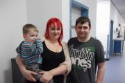 Former emergency department patient Gareth Scott, right, with his partner Phillipa Hall and their son Bobby Scott-Hall
