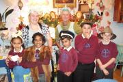 St Anne's Primary visit to For Teas cafe. From left at back, cafe owners Chay and Janet Croden. From left at front, pupils Melania Gallyasova, Aarya Shibu, Haris Khan, Joshua Colman and Billy Huckle.