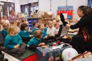 Storyteller Sita Brand, right, with children at Merlin Top Primary Academy