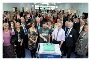 From left at the front, former patients Gareth Scott and Martin Quirk cut a celebratory cake at the preview launch of Airedale's new Emergency Department