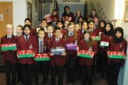 Holy Family Catholic School pupils with the gift-filled shoeboxes they have assembled to donate to the Samaritan's Purse charity