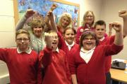 Cullingworth Village Primary School pupils celebrate the results with, from left, back, teaching assistant Mrs Jackie Ford, headteacher Mrs Kate Sutcliffe and teaching assistant Mrs Jane Dowd
