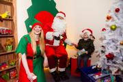 Santa in the Manorlands grotto at the Airedale Shopping Centre, with elf Rachel Walmsley and a young visitor