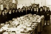Girls of Form 3B at Highfield Secondary Modern in 1964 with the Christmas cake
