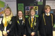Oakbank charity swimmers, from left, Agata Polisk, Ellen Woodger, Amelia Polisk and Seth Berry