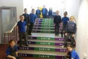 Pupils of Worth Valley Primary School in Bracken Bank on one of their new maths stairs