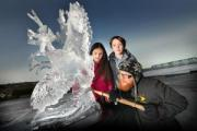 Ice sculptor Jamie Wardley with Ben Raine and Elise Gill (both 10) finishing off his work at Nessfield Primary
