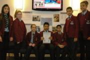 Holy Family Catholic School pupils with their newly-presented bronze Eco-Schools award