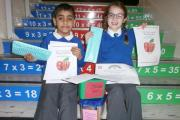 . Hamza Mahmood and Olivia Marshall, who won the Long Lee Primary School maths game competition