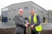 Airedale Springs chairman Tim Parkinson, left, is pictured outside the new factory on the day the keys were handed over in 2012 by Darren Seggar, co-owner of main contractor MSN Construction, of Long Preston, near Skipton