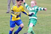 Keighley Shamrocks' Harry Bellamy makes a challenge on Albion Sports' Muhammad Mustafa