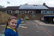 Haworth Primary pupil Tori Normington proudly points out her school's new solar panels