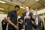 Minister of State for Business and Enterprise Matthew Hancock talks to student Derick Ngwana in the Industrial Centre of Excellence at Keighley Campus Leeds City College