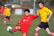 Silsden's Craig Nicholls tries to chip the Liverpool keeper