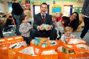 Aldi area manager Johnathan Kulik, centre, at the handover of goods to the Daisy Chain Children's Centre, in Silsden