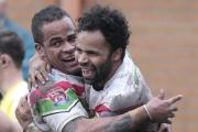 Jode Sheriffe helps celebrate brother Rikki's try for the Cougars against York – Picture: Charlie Perry