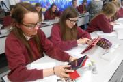 From left, South Craven School pupils Holly Waterworth and Lucy Lonsdale get to grips with their new handheld devices during a science lesson