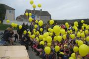 Nessfield Primary School pupils, staff and parents at the balloon launch