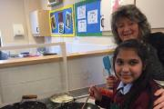 Holy Family Catholic School Cookery Club leader Sheila Hastings with pupil Aaliyah Saddique