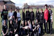 Keighley Cougars coach Paul March and Saima Hussain with the Laisterdyke rugby players