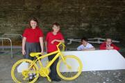 From left, Oxenhope Primary pupils Amy Evans, Adam Whitters, Aizak Andrews and Abigail Thornton in the bike storage with some of the decorative fixtures being installed around the structure