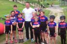 Bronte Tykes members proudly show off their new kit while meeting Olympic legend Sir Chris Hoy in Skipton recently